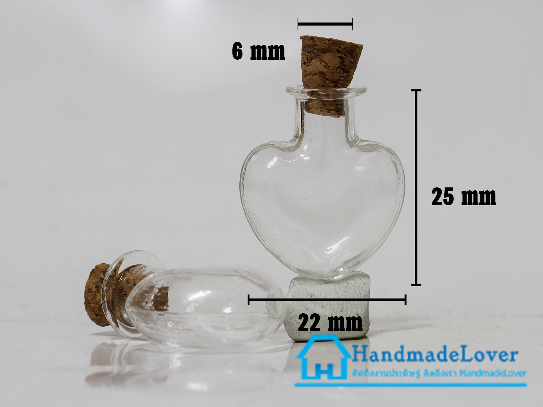 ขวดแก้วจิ๋ว (ฝาจุกไม้ก๊อก) รูปหัวใจ ขนาด 22 x 25 มม.