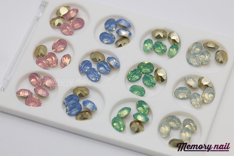 เพชรทรงวงรี ตูดแหลมมล ขนาด 7 มิล คละ4สี กล่องเหลี่ยมขาว