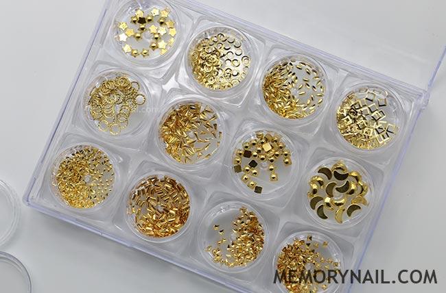 โลหะ และหมุดทรงต่างๆ สีทอง 1กล่อง มี12 แบบ
