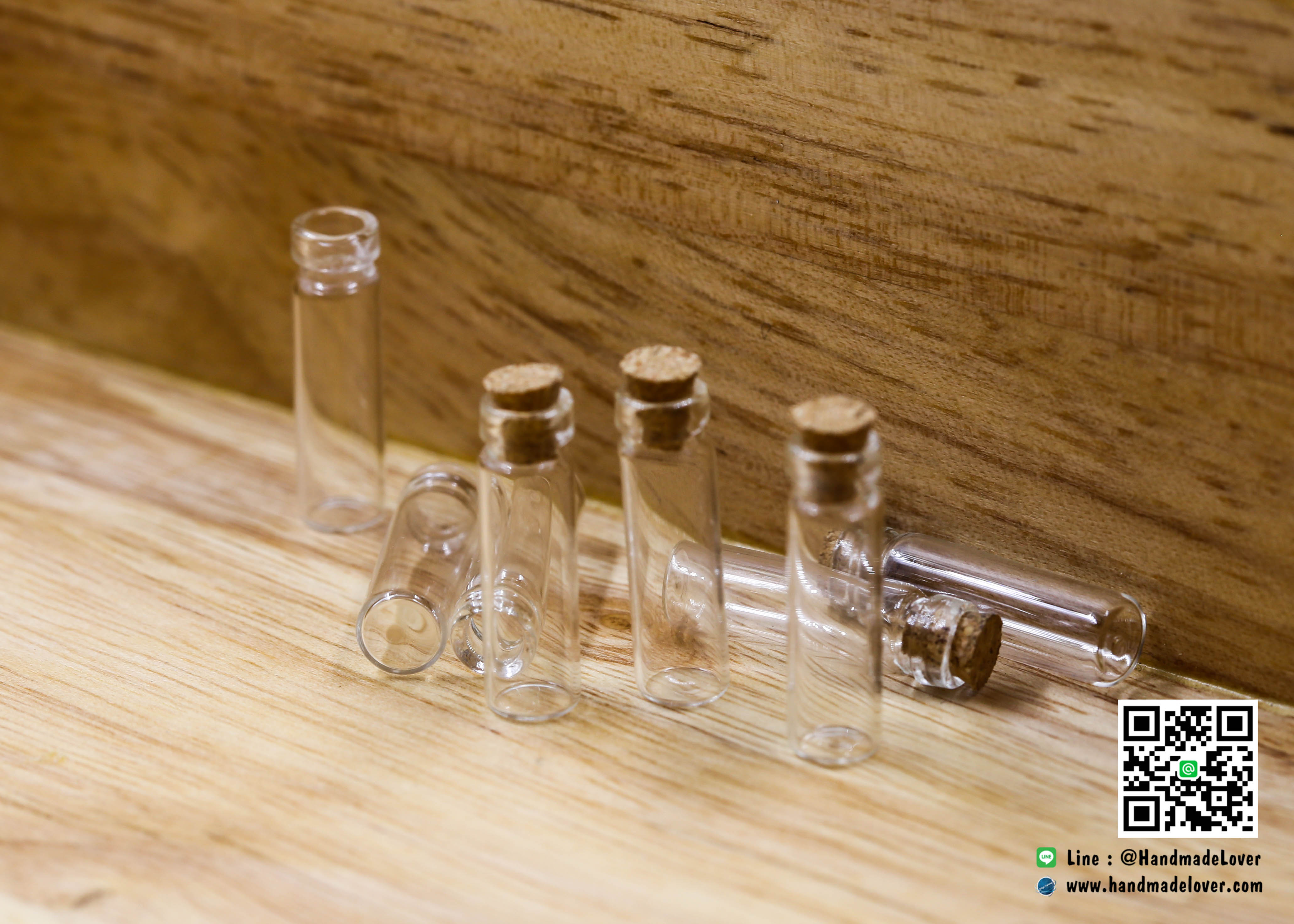 ขวดแก้วจิ๋ว (ฝาจุกไม้ก๊อก) ขนาด 7 x 24 มม (ปากขวด 4 มม)