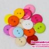 กระดุมพลาสติก ขนาด 12 mm (แพ็ค 50 เม็ด คละสี)