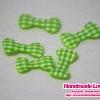 โบว์ลายสก๊อตสีเขียวตองอ่อน (แพ็ค 15 ชิ้น)