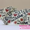 ริบบิ้นผ้า กรอสเกรน สีครีม พิมพิ์ลาย Love