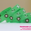 ริบบิ้นผ้า กรอสเกรน สีเขียวอ่อน พิมพ์ลายดอกไม้