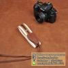 สายคล้องกล้อง cam-in Brown on the ground